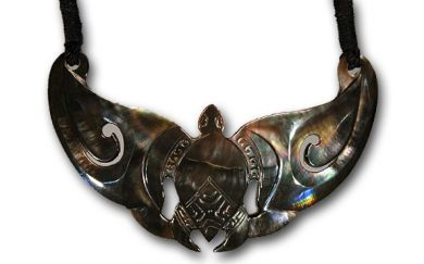 Mother or Pearl Boomerang with Carved Turtle
